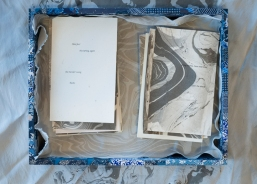 blue collaged box on silk suminagashi, cards inside box with text on another piece of silk